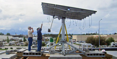Installing solar tracking array atop RES building